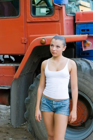 old tractor: Farmers daughter Stock Photo