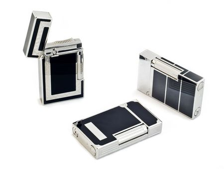 Three cigarette lighters on white isolated background photo