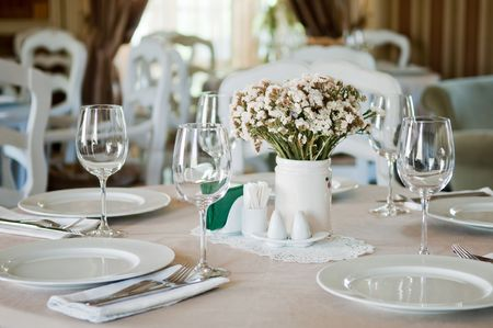 Fine table setting in beatiful gourmet restaurant Stock Photo - 8031512