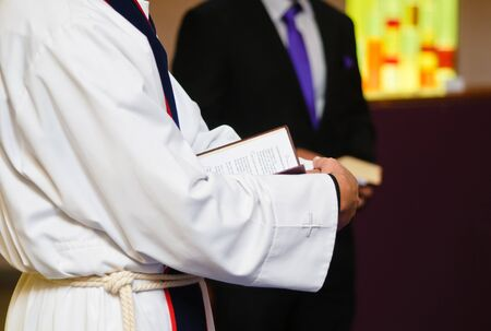 curch: Minister reading the Bible in the curch on wedding Stock Photo