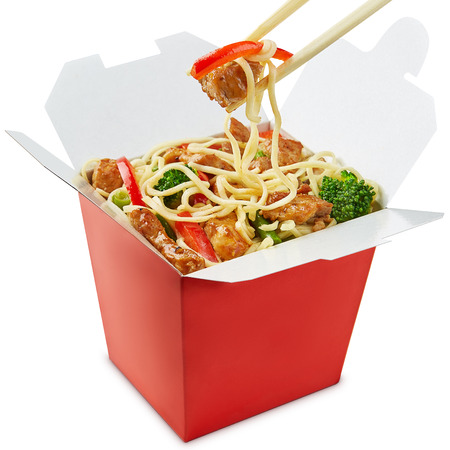 FOOD BOX: Wok noodles box with chopsticks  isolated on white background Stock Photo