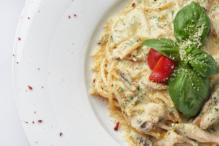 Italian spaghetti with sauce, mushrooms and basil leaf