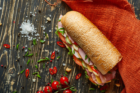 ingridients: Rustic sandwich with set of ingridients on an old wooden board