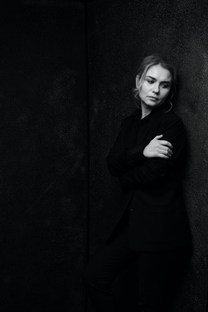Black and white portrait of a beautiful woman on a dark background 写真素材 - 111492423