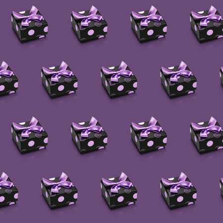 Abstract holiday sparse diagonal lines of packing isolated on violet. Set of realistic present boxes with bows and ribbons. Concept of holiday, festive background, wallpaper.