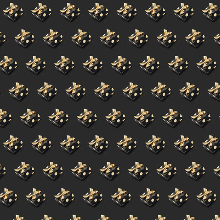 Rows of black present boxes small sized tied gold ribbons and bows on dark grey background. Can be used for wrapping paper for gifts for Fathers day, Black friday, Halloween.