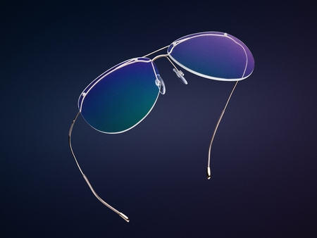 Fashionable rimless glasses isolated on dark navy blue background. Spectacles with chameleon and tinted lens. Nice modern aviator eyeglasses. Fashion concept