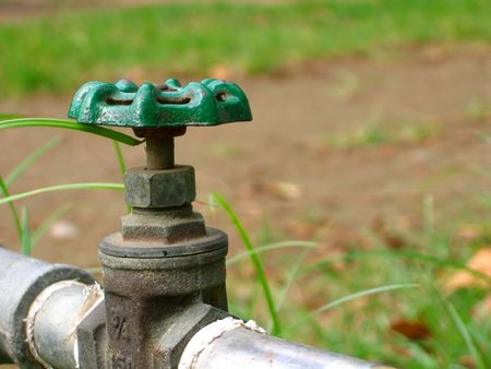 Closeup of a Water Faucet -- seen in a garden, for watering the plants