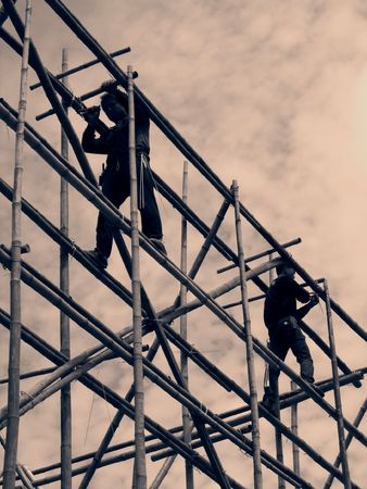 rickety: Bamboo Scaffolding -- with two men at work, vintage image Stock Photo