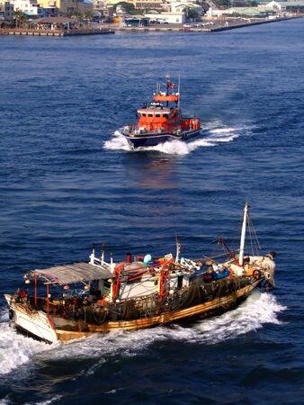 guard ship: Coast Guard Ship -- approaching an old fishing vessel