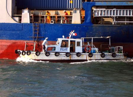 Harbor Pilot Boat -- along the side of a large container vessel Stock Photo - 462016