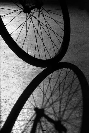 Bike Wheel -- an interesting display of shadow and light photo