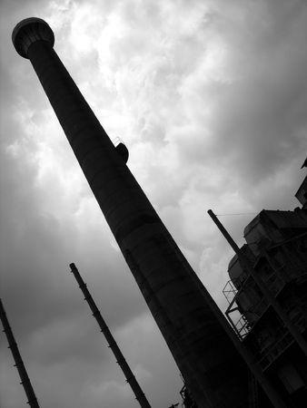 Deserted Factory -- with a towering chimney, seen in silhouette Stock Photo - 527986