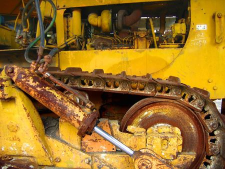 Old Bulldozer -- with rusty tracks and hydraulic parts