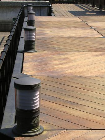 Wooden Deck -- with modern floor lights Stock Photo
