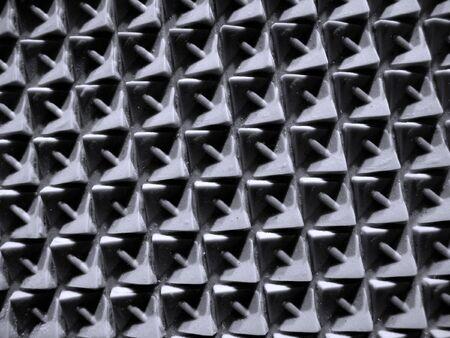 dauerhaft: Nahaufnahme einer Schuh-Sohle -- gebildet vom haltbaren Gummi, verwendbar als Hintergrund