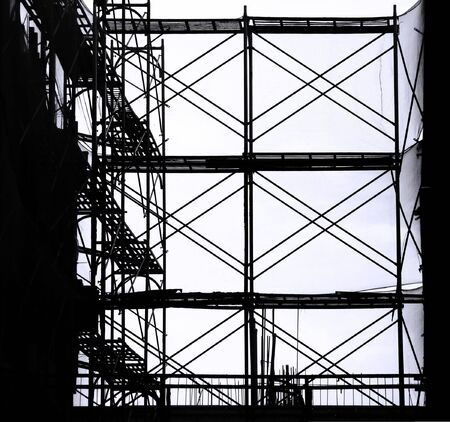 Construction Scaffolding-- seen as a silhouette with ladders and safety nets photo