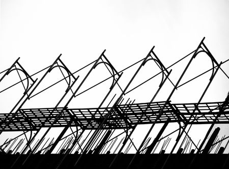 Construction Site Scaffolding -- seen as a silhouette with ladders and safety nets photo