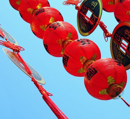Chinese New Year Ornaments -- fake coins and lanterns with Chinese characters that spell good luck and prosperity Stock Photo - 721065