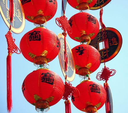 Chinese New Year Decorations -- fake coins and lanterns with Chinese characters that spell good luck and prosperity Stock Photo - 721063