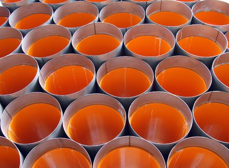 Drainage Pipes -- made out of orange PVC, with metal caps Stock Photo - 752276