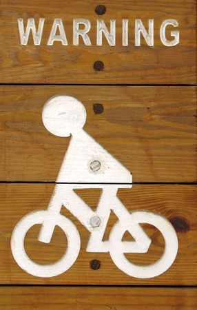 lengthy: Bicycle Path Warning -- made from wooden boards and white paint