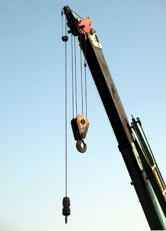 pulleys: Extendable Crane -- the tip of the arm with hook and pulleys Stock Photo