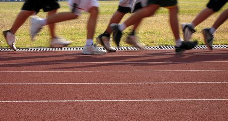 Joggers in Motion -- exercising on an outdoor athletic running track