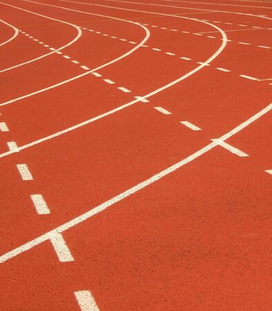 cushioned: Running Tracks -- in bright color, using crumb rubber