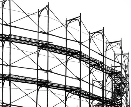 Construction Site Scaffold -- seen as a silhouette with ladders cross beams Stock Photo