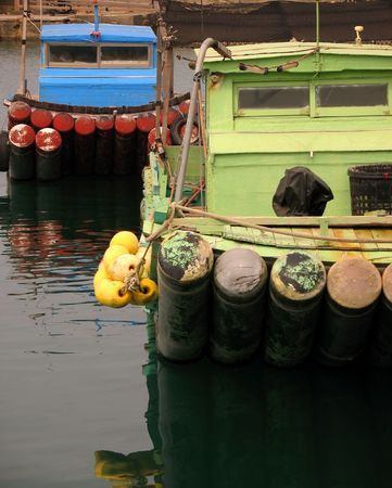 Small Fishing Boats -- docked in a small harbor in Taiwan Stock Photo - 828532