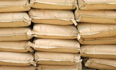 cement pile: Bags of Cement -- neatly stacked for a construction project Stock Photo