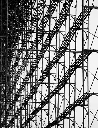 scaffold: Construction Scaffolding -- seen as a silhouette with walkways and cross beams Stock Photo