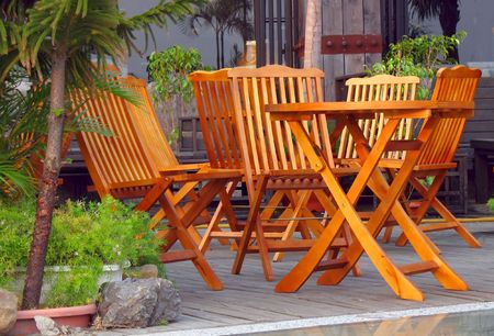 Garden Furniture -- wooden chairs and table, on a nice patio photo