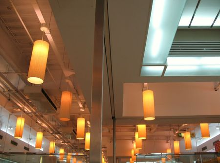 partitions: Restaurant Ceiling -- with hanging light fixtures and glass partitions Stock Photo