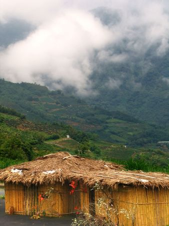 dwelling: Native Dwelling -- straw hut in Taiwans mountains shrouded in fog