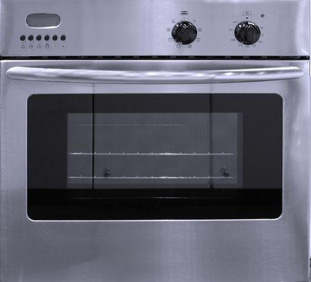 with electronic display, control knobs and oven Stock Photo
