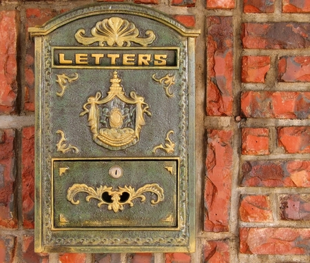 mail slot: Old Style Mailbox -- made from brass, mounted on a brick wall