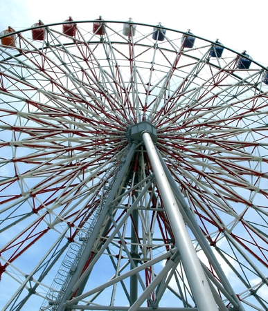 the height of a rim: Ferris Wheel -- a massive steel structure with intricate support beams
