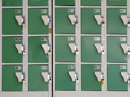 instructs: Row of Lockers -- the Chinese writing instructs the user to deposit a 10 Taiwan dollar coin