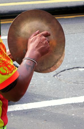 cymbals: -- a man is using traditional brass cymbals