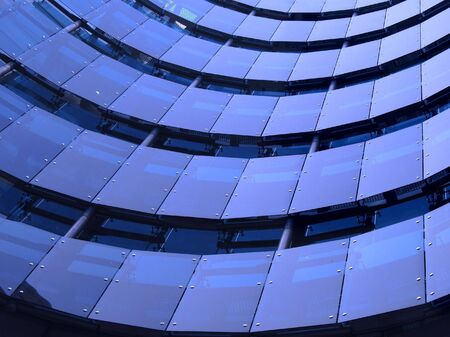 Modern Facade -- a concave building with tinted windows Stock Photo