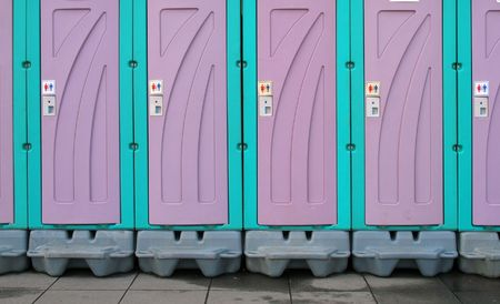 temporary: Temporary Toilets -- a row of portable toilets set up at a public event