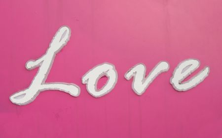 Love Sign -- an old outdoor sign with the word Love on it photo