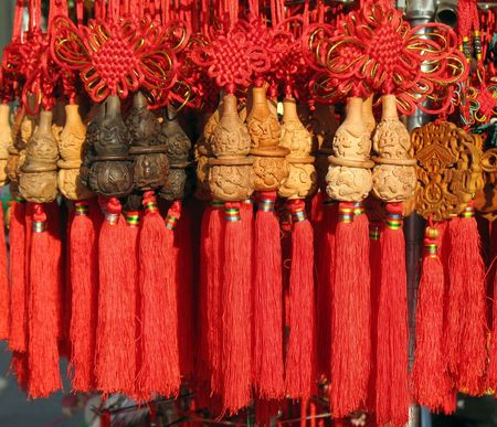 craft product: Carved Chinese Gourds -- Chinese craft product decorated with long red tassels