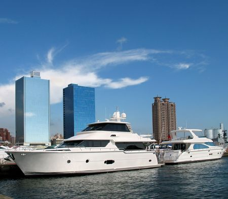 Luxurious Yachts -- anchored along the waterfront of Kaohsiung harbor in Taiwan