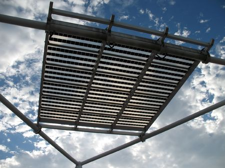 solarcell: Solar Panels -- supported by iron beams; seen against a summer sky