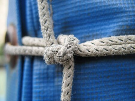 Close up image of a knotted rope and tarp Stock Photo