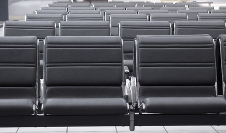 cushioned: Waiting area with empty seats in a modern train station