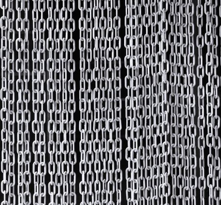 vertical divider: A curtain made from gray plastic chains